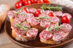 Bread with sliced salami Stock Photography