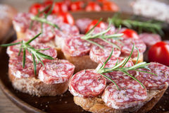 Bread with sliced salami Stock Photos