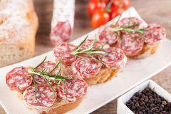 Bread with sliced salami Royalty Free Stock Photography