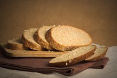 Bread slices. Multi-grain bread slices on wooden board royalty free stock photos