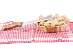Bread slices in basket on tablecloth. Stock Image