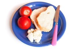 Bread slices, cream cheese and tomatoes on a plate Royalty Free Stock Photo