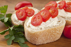 Bread slices with cream and tomatoes Stock Photography