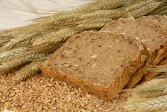 Bread slices and natural cereals. Slices of fresh German bread decorated with natural cereals Royalty Free Stock Images
