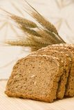 Bread slices and natural cereals Stock Image