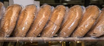 Slices of bread in bag stock image