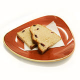 Bread slices on red plate. Cranberry bread Royalty Free Stock Image