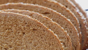 Bread slices at rotating stand - closeup. HD 1080 static: Bread slices at rotating stand - closeup stock video