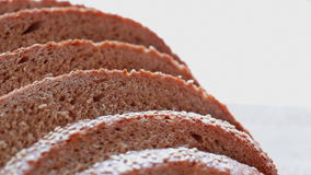 Bread slices at rotating stand - closeup. HD 1080 static: Bread slices at rotating stand - closeup stock footage