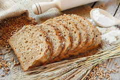 Bread slices and rye spikelets Stock Photos