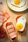 Bread slices with tomato relish, turkey rasher and fried egg Royalty Free Stock Photography