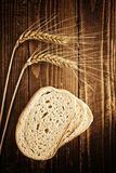 Bread slices, wheat ears and grains Royalty Free Stock Photography