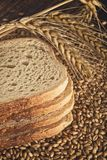 Bread slices, wheat ears and grains Stock Photo