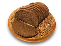 Bread slices. Bread slices and wheat seeds on the wooden board Royalty Free Stock Photos