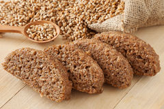 Bread slices from wheat sprouts and seeds in hessian bag Stock Photography
