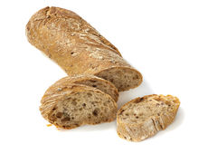Bread with slices on white Royalty Free Stock Photo