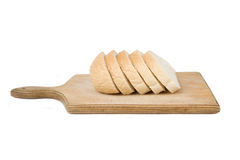 Bread slices on wood cutting board Royalty Free Stock Images