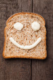 Bread smiley. Happy smiley made from mayonnaise on slice of bread Royalty Free Stock Photos