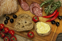 Bread with smoked salami and  cheese cream Royalty Free Stock Images