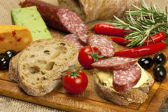 Bread with smoked salami and  cheese cream Royalty Free Stock Image