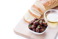 Bread With Some Black Olives. Bowl of black olives with fresh herbs royalty free stock photo