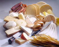 Bread and something. Bread, cheese and sausages arrangement Stock Image