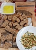 Bread and spices. Pieces of healthy rye bread and spices for melting. Gourmet royalty free stock photography