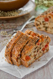 Bread with spices and vegetables. Bread with spices, cherry tomatoes and aubergine royalty free stock image