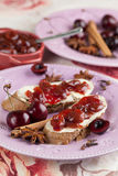 Bread with spicy cherry jam Royalty Free Stock Images