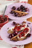 Bread with spicy cherry jam. Bread with homemade spicy cherry jam. Shallow dof stock photo