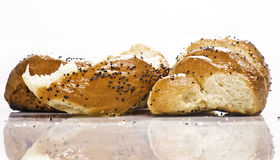 Bread spiral. Delicious bread  with poppy isolated and reflection on white Royalty Free Stock Images