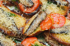 Bread with sprats, tomato and cheese. Stock Image