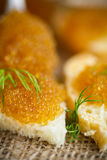 Bread spread with salted pike caviar Royalty Free Stock Image