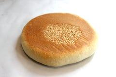 Bread sprinkle sesame on white background. Stock Photos