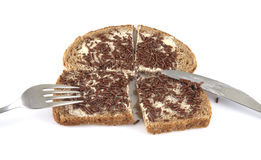 Bread with sprinkles. Bread with chocolate sprinkles on a white background Royalty Free Stock Photography