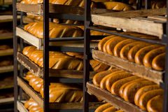 Bread stacked on the shelves. Stock Image