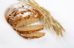 Bread and stalks of wheat Stock Photography
