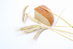 Bread and stalks of wheat Stock Photos