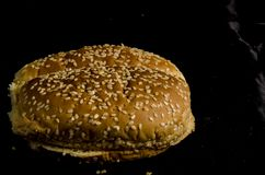 Hamburger buns with lot`s of seed`s. Bread is a staple food prepared from a dough of flour and water, usually by baking. Throughout recorded history it has been royalty free stock photography