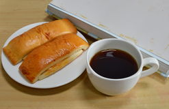 Bread stick and black coffee with photo album Royalty Free Stock Images