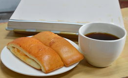 Bread stick and black coffee with photo album Stock Images