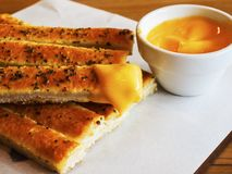Bread stick. Breadsticks may be offered at the table in restaurants as an appetizer. In some instances or regions they may be a type that is larger than pencil Stock Image