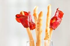 Bread-stick con el jamón de Parma Foto de archivo