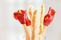 Bread-stick with parma ham Stock Photo