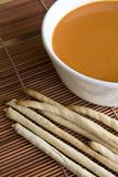 Bread stick and tomato soup Stock Photography