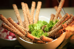 Bread sticks. With sesame on a white bowl as a starter Royalty Free Stock Image