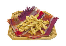 Bread sticks in basket with napkin. Several garlic and parmesan cheese bread sticks in wicker basket and napkin on a white background Stock Photos