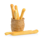 Bread sticks in basket on white background Stock Image