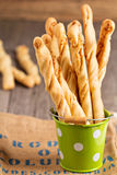 Bread sticks with cheese. In a bucket Royalty Free Stock Photos