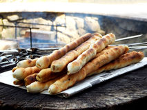 Bread sticks of dough cooked on a fire. Royalty Free Stock Photography